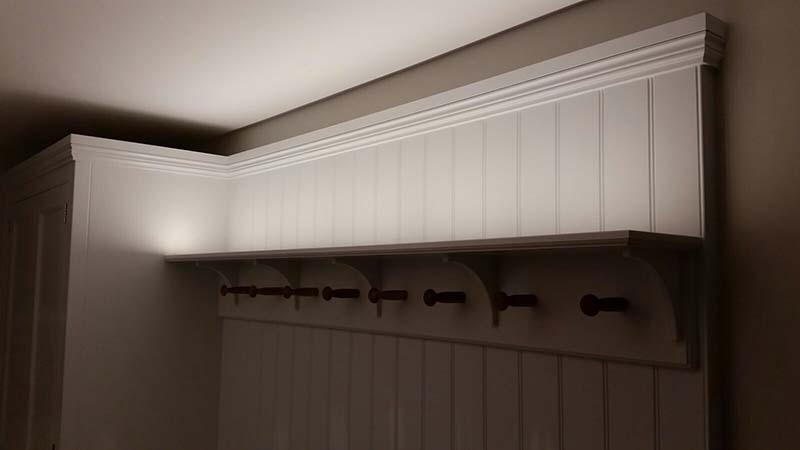 Bespoke boot room at house in Epping, Essex. Oak internals. Concealed led uplighters in shelves.