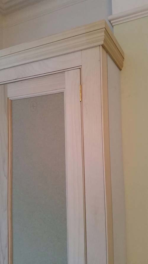 Detail of traditional fitted alcove unit at Victorian house in Hither Green