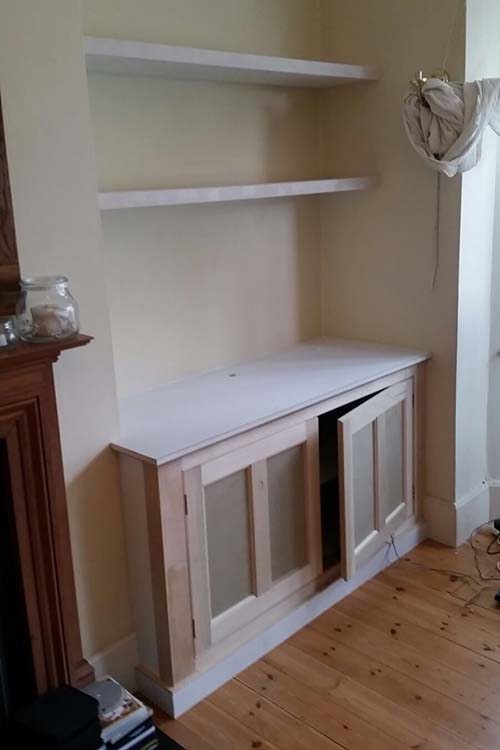 Alcove units at house in Muswell Hill. Left hand unit incorporating knee hole for use of laptop on unit.