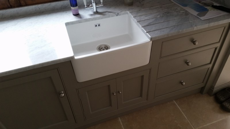 Bespoke boot room at barn conversion near Bishops Stortford on the Essex/Herts border. Traditional belfast sink/butlers sink unit with marble top. Left cupboard to take a mini-fridge, right side with drawers on full extension soft-close runners