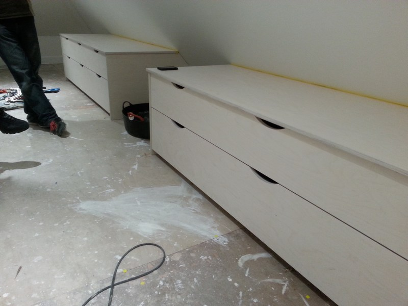 Contemporary drawer units in loft conversion in Shenfield, Essex. Finish is lime effect birch ply with hardwax oil on top. Three units, all approx 8ft long